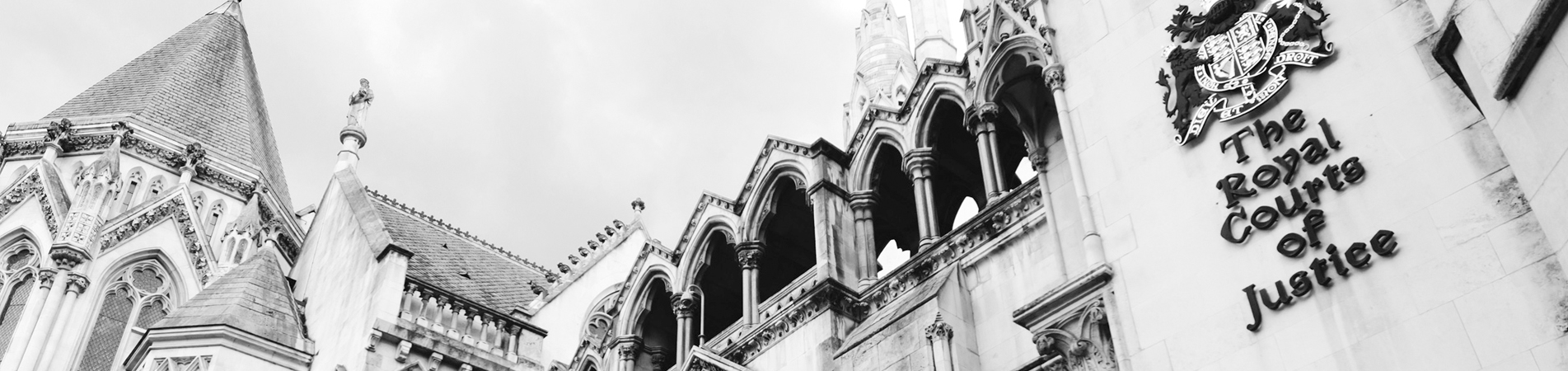 Black and White Image of the Top of The Royal Courts of Justice